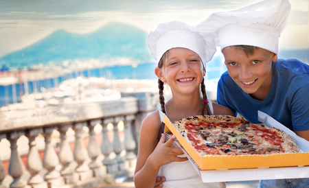 Cute kids holding pizza