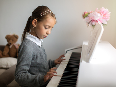 Cute little girl playing piano