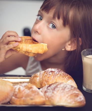 Cute little girl has breafast
