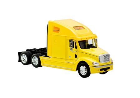 yellow toy truck isolated over white background Standard-Bild