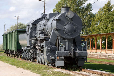 steam locomotive with three freight cars in historical museum photo