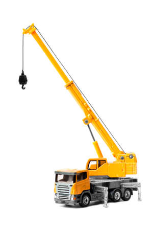 yellow toy truck crane isolated over white backgroung photo