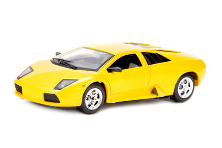 sportcar: yellow toy sportcar isolated over white background