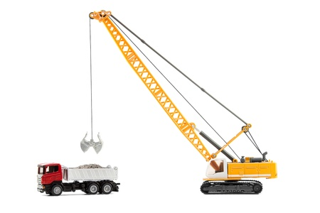 The cable excavator loading of heavy dump-body track isolated over white background photo