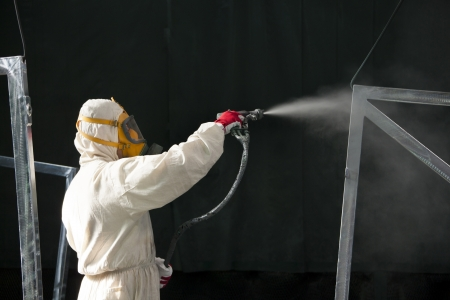 paint gun: painter painting metal designs with airbrush Stock Photo
