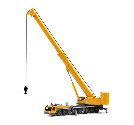 yellow toy truck crane isolated over white backgroung