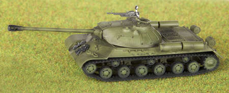 model of old soviet tank isolated over grass background  photo