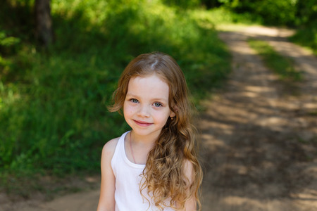portrait of a beautiful young girl with long hair outdoors in summer Stock Photo