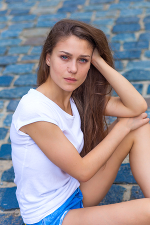 green eyes: portrait of a beautiful girl with green eyes outdoors in summer Stock Photo