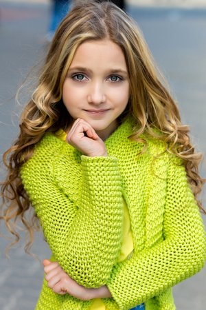 cardigan: portrait of a beautiful blonde girl in a green cardigan