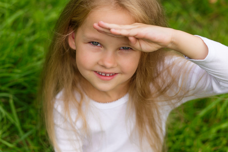 tightness: Portrait of a beautiful little girl with blond hair