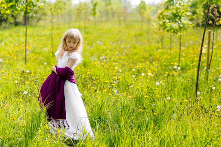 Young woman with in green park. Cute young blond girl outdoors in summer Stock Photo