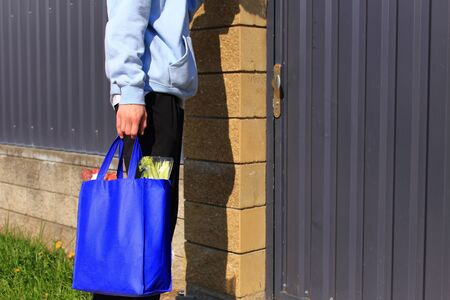 Young guy with a bag of products in his hands.