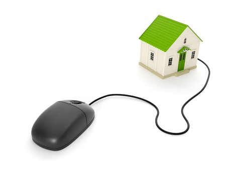 3d illustration: Back home. The toy house and a computer mouse