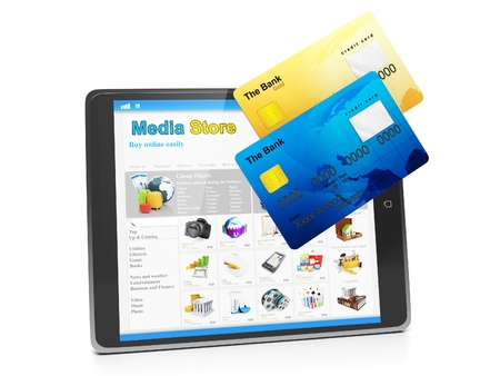 Tablet PC, payment for goods in the media store. Tablet computer and group of close-up of credit cards Stock Photo - 17365556