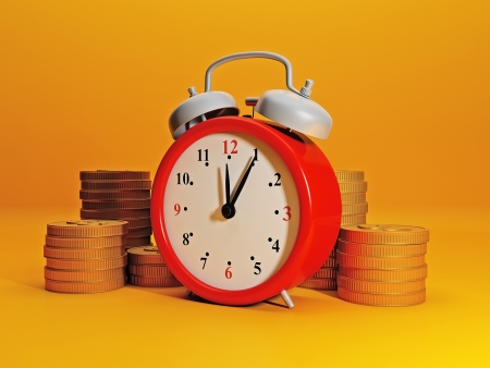 Time to earn money. Alarm clock symbolizes time and team gold. Efficient business, great income in a short time Stock Photo - 17365571