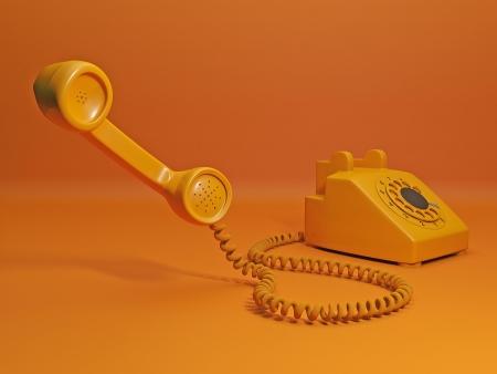 telefono antico: Chiama per ordinare un taxi. Telefono arancione e il portatile è vicino alla fotocamera Archivio Fotografico