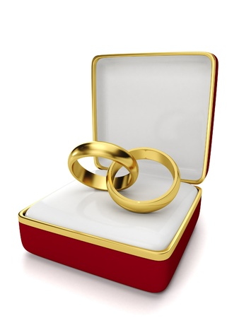 Gift box with two wedding rings on a white background photo