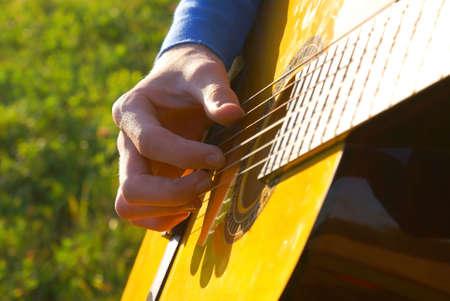ballad: playing guitar