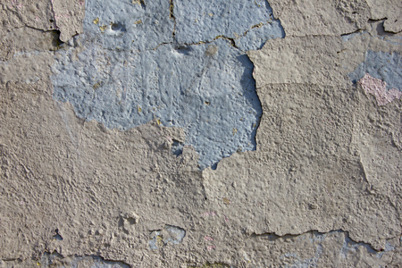 Old wall. Cracked plaster. Repair is required. Emergency condition Repair of premises. Background old plaster. Several layers of plaster. 写真素材