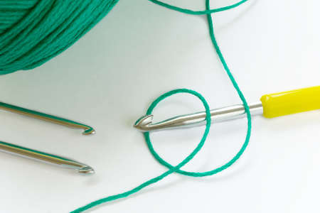 Crochet thread and tools. Needlework crochet on a light background. Banco de Imagens