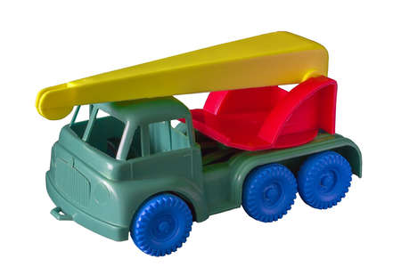 Children's toy car crane isolate on a white background. Plastic car close-up isolate on white background