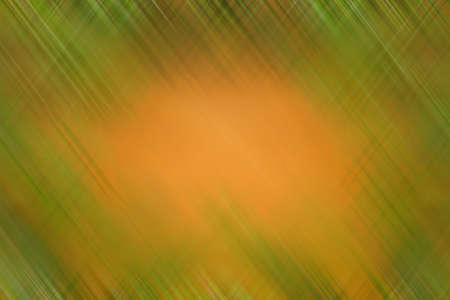 Abstract orange-green background with blurred strokes. Table background soft green and yellow abstraction