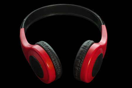 Subject red headphones with black bow isolate on black background Banco de Imagens