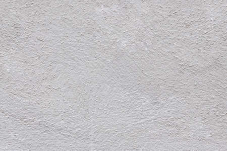 light gray concrete wall texture evenly illuminated. gray rough background with small inclusions