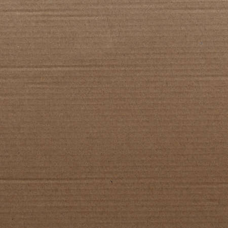 Evenly illuminated thick cardboard texture close-up view top