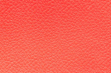 red uniform background of embossed material