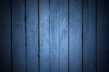 background of vertical arranged planks painted blue with deep veneering