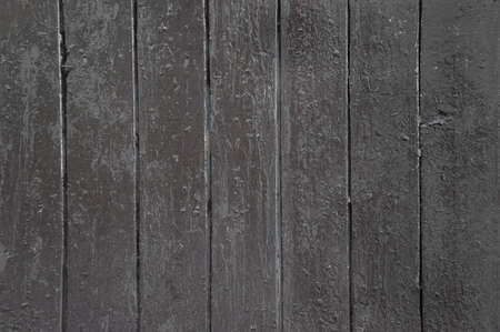 dark texture of vertically arranged boards painted with old paint in pale brown
