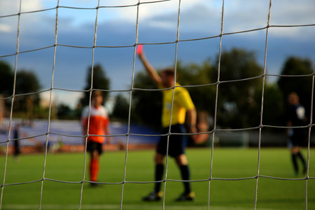 fairplay: The football net with referee on the background Stock Photo