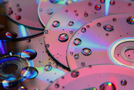compact disk: Compact disk splattered by water Stock Photo