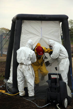 The person in chemical protection suit go out from danger zone and undergo the process of purification