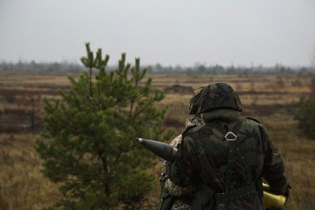artillery shell: Soldiers pass artillery shell Stock Photo