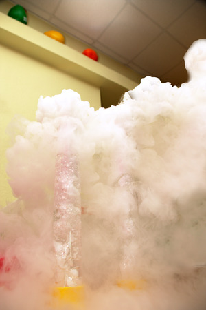 smoldering: Smoldering flask  after the chemical experiment in a laboratory Stock Photo
