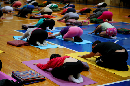 yoga class in fitness studio photo