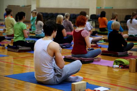 yoga class in fitness studio photo