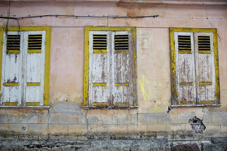 shutting: The three windows of old house with shutting shutters