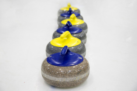 The stones for game in curling on ice