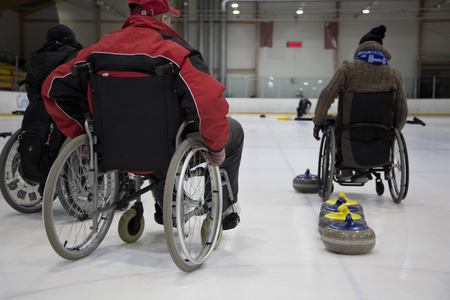 The Paralympic curling training wheelchair curling. Invalid sport Standard-Bild