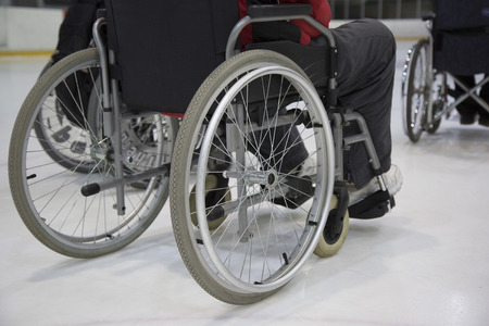 The invalid person on the wheelchair on the ice