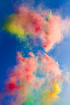 Abstract: varicoloured daytime fireworks in the blue sky Standard-Bild