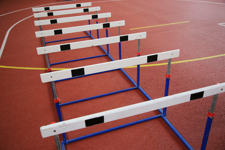 Row of cross-country barriers in the indoor athletics hall
