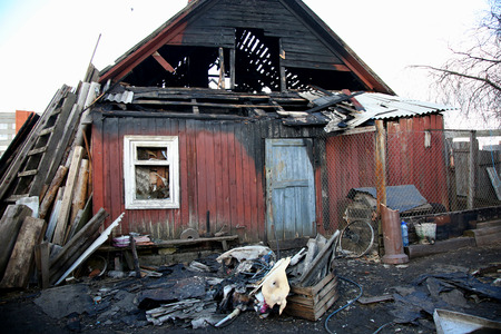 burned out: conflagration. Elements of the burned wood house Stock Photo