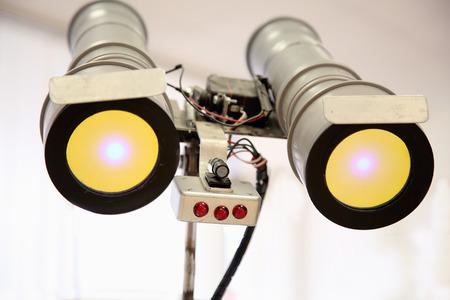 telescopic: telescopic eyes robot with yellow light. Technic