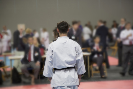 fighting styles: Karate man waiting decesion of judges on tatami Stock Photo