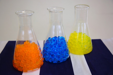 flasks: glass flasks with colored balls - orange, blue, yellow